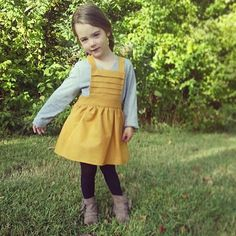 FALL is here! This classic pinafore dress can be worn year around. Just put with a t-shirt during warmer months and for cooler days, layer with tights, long sleeve and a beanie. This is a no-fuss piece that is easy to slip on and off -- Mommas happy. Material: Cotton Care: Gentle cold