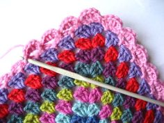 Shell edging on granny square blanket. Gorgeous colors, beautiful crocheting