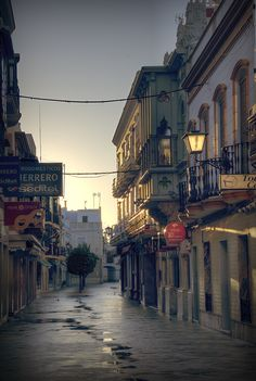 """Ayamonte´s street by Ramon Martín. We """"hopped over' from Portugal and had a nice tapas lunch here once."""