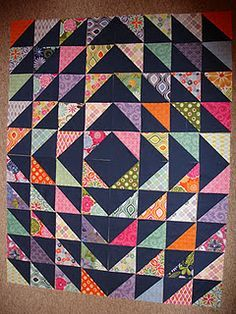 HSTs quilt..... oh, I could do this with some of the charm squares I have.                                                                                                                                                                                 More