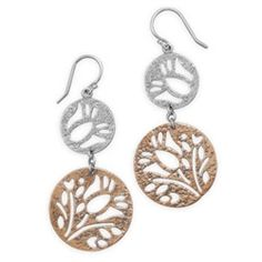 Floral cut out design disc drop french wire earrings. The sterling silver disc measures 16mm and the copper disc is 25mm. The earrings hang approximately 56mm.  .925 Sterling Silver