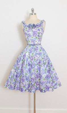 ➳ vintage 1950s dress  * lavender floral print cotton * detachable belt * floral accented neckline * rhinestone accents * metal back zipper  condition | excellent  fits like medium  length 39.5 bodice 15.5 bust 38-40 waist 27-28 hem allowance 1.75  some clothes may be clipped on dress form to show best fit for appropriate size.  ➳ shop http://www.etsy.com/shop/millstreetvintage?ref=si_shop  ➳ shop policies http://www.etsy.com/shop/millstreetvintage...