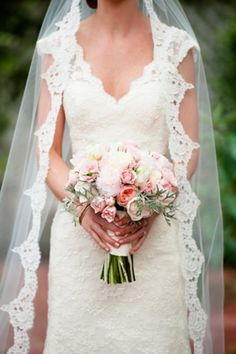 Gorgeous bride in lace wedding veil and gown #bouquet #lace #white  Photo by: Holly Gardner Photography on Every Last Detail