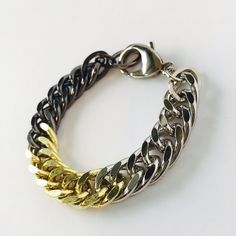 "L.George Mix Metal Fishtail Bracelet. Create your perfect stack with this beautiful Mix Metal Fishtail bracelet from L. George. Approx Measurements: 7.5"" Long x 0.5"" W. Handcrafted in Atlanta. A50 L.George Designs Jewelry Bracelets"