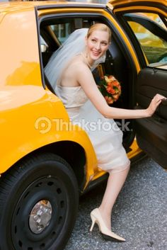 bride coming out of yellow cab