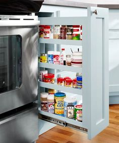 This slide-out rack keeps spices easily accessible next to the stove.