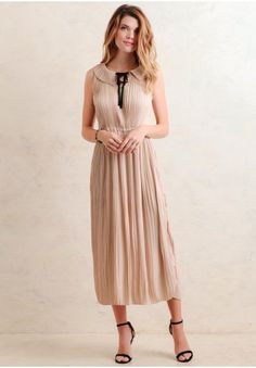 A stunning maxi dress with a pleated design. Form fit, style this dress with any seasonal accessories to layers for the perfect holiday outfit.
