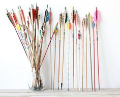 A fantastic set of colorful vintage arrows. A perfect graphic pop of color for a room.  Arrows are wood & aluminum mix - some arrows have metal