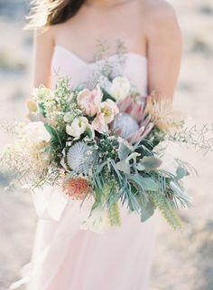 Desert inspired protea bouquet: http://www.stylemepretty.com/little-black-book-blog/2016/05/13/engagement-rings-chic-competition/ | Photography: Oliver Fly Photography - http://oliverfly.com/