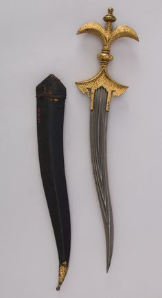 Chilanum Dagger with Sheath Dated: century Culture: Indian Medium: Iron, gold, leather Measurements: H. with sheath 16 in. without sheath 15 in. of blade 10 in. of sheath oz. Pretty Knives, Cool Knives, Swords And Daggers, Knives And Swords, Shuriken, Draw Tips, Katana, Knife Aesthetic, Cool Swords