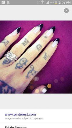 Black tip almond nails.