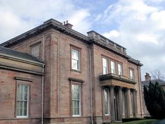 Aikenhead House, King's Park, Glasgow. Main house built 1806, side wings added 1823. Converted to flats.