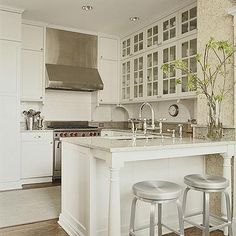 I want to add those little cabinets at the top. And I like the simple stainless vent hood.