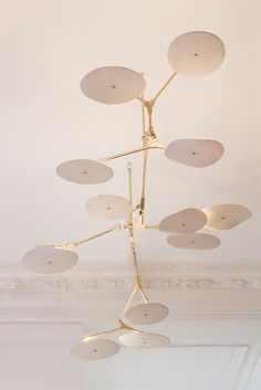 lindsey adelman with porcelain shades and brushed brass hardware.