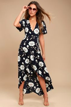 The Lake Como Navy Blue Floral Print High-Low Wrap Dress is fit for an Italian villa vacation! Lightweight woven floral print wrap dress with a high-low skirt.
