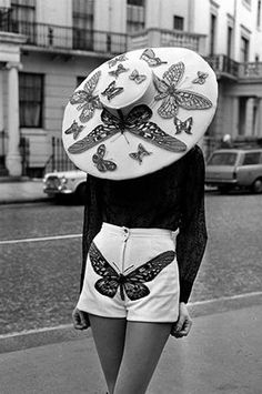 Simone Mirman: Milliner to the Queen - Nikki :: Wise Apple Vintage - Simone Mirman: Milliner to the Queen Outfit: Hot pants, 1971 white novelty print shorts vintage fashion style photo print ad street style designer butterfly applique hat early - Fashion Mode, Retro Fashion, Womens Fashion, Arty Fashion, Fashion Hats, Butterfly Fashion, Moda Vintage, Vintage Hats, Mode Inspiration