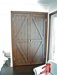 Custom Made Custom Reclaimed Wood Bi-fold Closet Doors for a Luxury Home in Malibu by TomiSchlusz