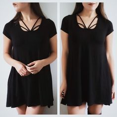 Black strappy tunic top/mini dress Black strappy tunic top with unbalanced hem. Soft, stretchy material.  Fabric content: 95% rayon 5% spandex Fit: loose fit, length runs small for a dress, more of a top length    • Price is firm • April Spirit Dresses