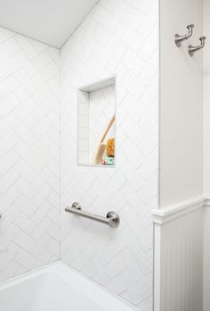 Shower shelf in a bathroom renovation by Madeleine Design Group in Vancouver *Re-pin to your own inspiration board*