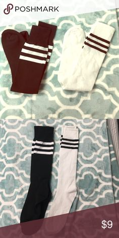 NEW! 2 Pairs of knee high fashion socks! One size! Black pair and white pair. Look like soccer socks but they are for fashion. Knee high with 3 stripes at top. Never worn! Brand new out of the package! Accessories Hosiery & Socks