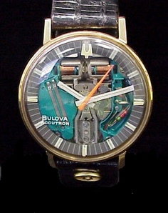 """This beautiful Accutron Spaceview is what we refer to as the """" 3-6-9"""" because of the configuration of markings on the Genuine Spaceview Crystal.  It's designed with large hash marks at the 3, 6, and 9 o'clock positions, with the tuning fork at the 12, and the words Bulova Accutron at the 8 position.  This Spaceview has a stainless colored movement.  The electroplated Yellow Gold Bezel is in the Swiss style case, measuring 36mm in width and 42mm lug tip to tip.Case back dates this model as a…"""