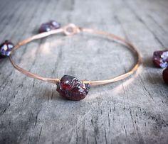 A personal favorite from my Etsy shop https://www.etsy.com/listing/227018000/genuine-rough-cut-garnet-bracelet