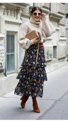 If you gravitate towards relaxed casual getups, why not take this combo of a beige knit turtleneck and a navy floral maxi skirt for a spin? To add a bit of oomph to this ensemble, introduce a pair of tobacco suede knee high boots to the mix.