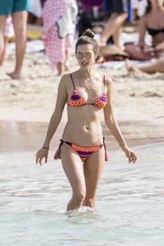 See all the swimsuits Alessandra Ambrosio sported during her Summer vacation and…