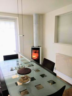 White Contura stove in a New Forest dining room. A C810G:2 woodburner with full glass door, installed by Rob Chalmers, Forest Sweep. Stove Installation, New Forest, Stoves, Wood Burning, Glass Door, This Is Us, Dining Room, Doors, Home Decor