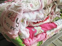 Memory quilt made from old baby clothes. I need to find someone to make this for my girls :)
