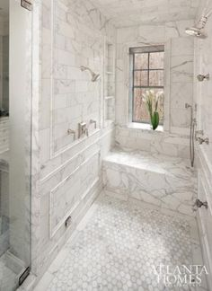 Marble bathroom, not sure if I like the marble so much but love the honeycomb pattern on the floor