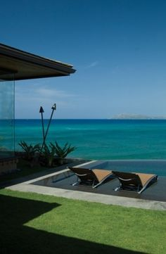 tropical pool by Philpotts Interiors - love the shallow area for chaises