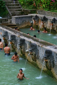 Enjoying the holy hot springs of Air Panas Banjar - Bali, Indonesia