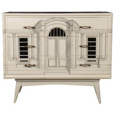 Fornasetti style commode having three drawers with Neoclassical inspired architectural building façade decorated front, top and sides. Raised on tapering legs