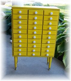 Reserved for Melissa  Storage Cabinet 30 Drawer Handmade Upcycled Renewed Yellow with White Porcelain Knobs Organizer Beads Jewelry. $175.00, via Etsy.