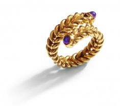 Inesiene Braid ring with amethysts    Amazing twisting and wrapping effect which can only be achieved sewing this braid ring by hand. This motive and technique was a favourite in ancient Greece and Rome.     Two round and incredibly fine amethyst cabochons decorate the ends.     Made by hand in solid silver 24 carat goldplated with 5 microns. Hallmarked on the inside with 925 and IN marks demonstrating the quality materials and signed INESIENE to confirm its provenance.     £295
