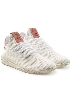 a38a8c28b89 In collaboration with Pharrell Williams, these 'Tennis HU' sneakers from  Adidas Originals are crafted with a white breathable mesh upper and a ...