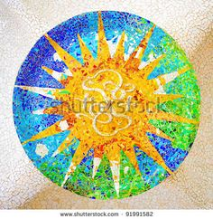 Ceiling with a sun mosaic at the Parc Guell designed by Antoni Gaudi, Barcelona, Spain. by catwalker, via ShutterStock