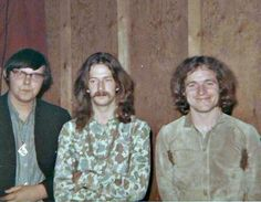 Jack Bruce, Eric Clapton & Friend. Clapton's either unsure of photographers position or depressed.