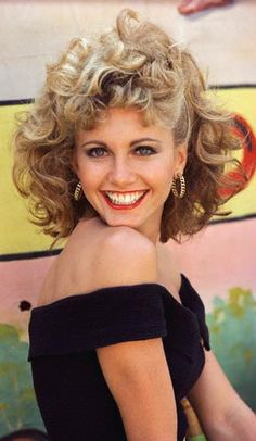 Sandy in Grease. On Broadway: Sandy Dumbrowski. In the movie: Sandy Olsson.