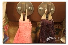 sew loops onto towels so they STAY ON the hook! yes please! This is one of those you say... why didnt I think of that?