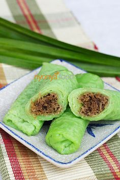 Kuih dadar or kuih tayap|| flour, egg, coconut milk, pandan juice, Gula Melaka (Malaysian palm sugar), pandan leaf, grated coconut (white part only), corn starch