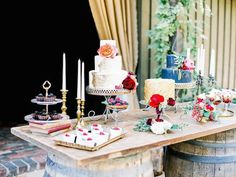 Door resting on 2 Tall Spools instead of barrels for cake and desserts. Door is cheap and we'd use what is at the venue already. It would go well.