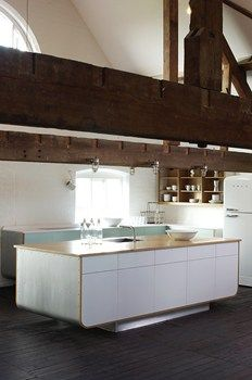 Love the combination of traditional wood beams with modern clean Hi-Macs island.