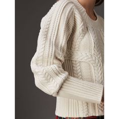 A sweater textured with multi-stitch cable-knits in wool and cashmere. Finished with a chunky ribbed trim, an elongated cuff shapes the enveloping design at the wrist. Pair with runway-inspired tartan or denim for off-duty days.