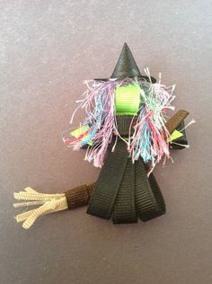 Halloween Spooky Witch on broom ribbon hair clip. $6.00, via Etsy-love the hair