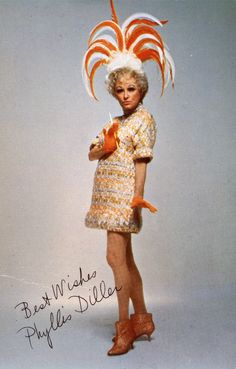 Phyllis Diller in orange with brocade.