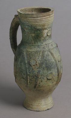 Jug Date: late 1200s–early 1300s Geography: Made in Paris or its vicinity, France Culture: French Medium: Partially glazed earthenware   The Metropolitan Museum of Art