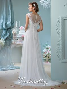 mon cheri bridals 116137 - Tulle A-line gown with cap sleeves, illusion bateau neckline over semi-sweetheart bodice with lightly hand-beaded lace appliqués, illusion back with covered buttons and matching appliqués, gathered skirt with chapel length train.