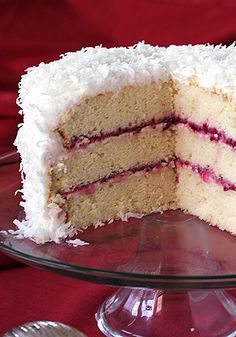 A fluffy white coconut cake layered with a coconut cream cheese frosting and a thin jewel-like layer of cranberry sauce. It looks like a giant snowball and it tastes like a tropical slice of holiday heaven. Christmas Desserts, Christmas Baking, Christmas Cakes, Christmas 2014, Holiday Baking, White Christmas, Cake Recipes, Dessert Recipes, Cupcake Cakes